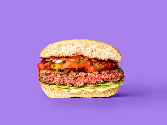 """The Impossible Burger sets itself apart from other faux burgers as a burger that """"bleeds."""" The raw patty is the color of raw ground beef, and it cooks up something like ground beef. The patty is made from wheat protein, potato protein, coconut oil and heme. Heme? According to the Impossible Foods website, """"(Heme) is responsible for the characteristic taste and aroma of meat, it catalyzes all the flavors when meat is cooked."""" (Impossible Foods)"""