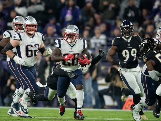 Nov 3, 2019; Baltimore, MD, USA; New England Patriots running back Sony Michel (26) rushes during the first half against the Baltimore Ravens at M&T Bank Stadium. Mandatory Credit: Tommy Gilligan-USA TODAY Sports
