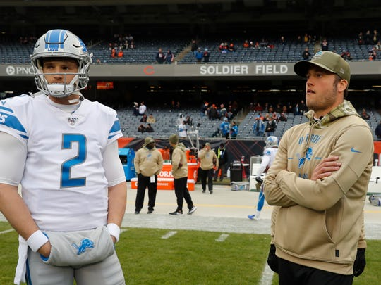 Detroit Lions quarterback's Jeff Driskel (2) and Matthew Stafford watch during warmups before an NFL football game in Chicago, Sunday, Nov. 10, 2019. (AP Photo/Charles Rex Arbogast)