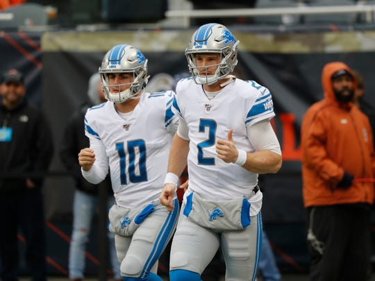 Lions quarterbacks David Blough (10) and Jeff Driskel (2) run on the field before the game against the Bears in Chicago, Nov. 10, 2019.