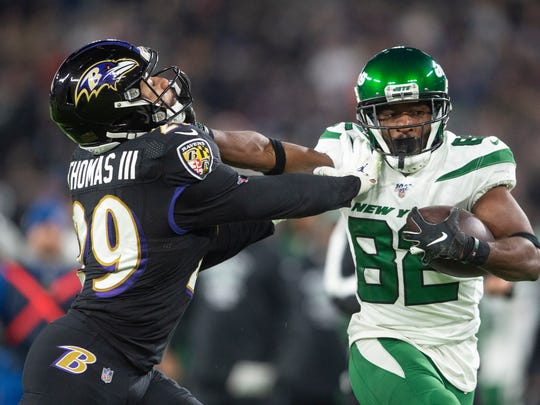 Dec 12, 2019; Baltimore, MD, USA; New York Jets wide receiver Jamison Crowder (82) stiff arms Baltimore Ravens free safety Earl Thomas (29) during the second quarter at M&T Bank Stadium. Mandatory Credit: Tommy Gilligan-USA TODAY Sports