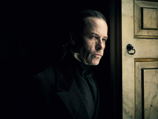 """Guy Pearce as Ebenezer Scrooge in the FX film """"A Christmas Carol."""""""