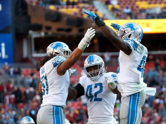 Detroit Lions middle linebacker Jarrad Davis, right, celebrates with teammates Jahlani Tavai (51) and Devon Kennard (42) after recording a sack on Washington Redskins quarterback Dwayne Haskins during the second half of an NFL football game, Sunday, Nov. 24, 2019, in Landover, Md. (AP Photo/Alex Brandon)
