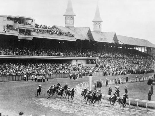 In this June 9, 1945, file photo, Hoop Jr. leads by a length during the 71st running of the Kentucky Derby horse race at Churchill Downs in Louisville, Kentucky. This year is the first time the Derby won't be held on the first Saturday in May since race. This year's Derby is postponed until Sept. 5, due to concern over the coronavirus pandemic.