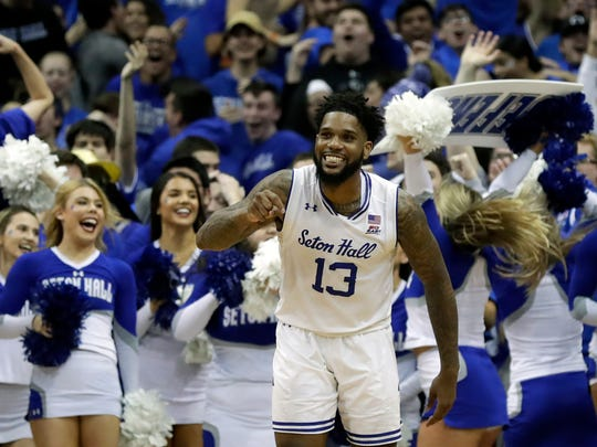 FILE - In this Nov. 14, 2019, file photo, Seton Hall guard Myles Powell (13) reacts against Michigan State during the second half of an NCAA college basketball game in Newark, N.J. Powell was selected to The Associated Press All-America first team, Friday, March 20, 2020.  (AP Photo/Adam Hunger, File)