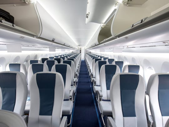 An empty airline cabin.