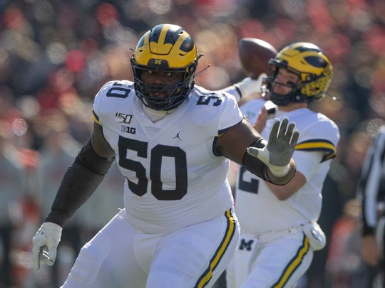 Nov 2, 2019; College Park, MD, USA;   Michigan Wolverines offensive lineman Michael Onwenu (50) blocks as quarterback Shea Patterson (2) loos to throw during the first half against the Maryland Terrapins at Capital One Field at Maryland Stadium. Mandatory Credit: Tommy Gilligan-USA TODAY Sports