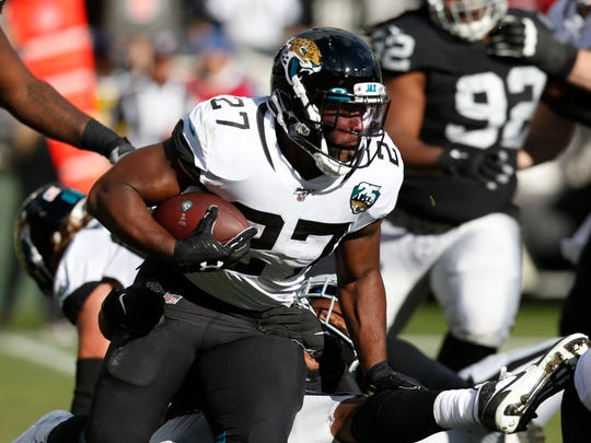 FILE - In this Sunday, Dec. 15, 2019 file photo,Jacksonville Jaguars running back Leonard Fournette runs with the ball during the second half of an NFL football game against the Oakland Raiders in Oakland, Calif. The Jacksonville Jaguars are ready to move on from running back Leonard Fournette, Monday, April 20, 2020. A person familiar with the decision says the Jaguars are actively looking to trade the fourth overall pick in the 2017 NFL draft. The person spoke to The Associated Press on condition of anonymity because the team hasn't made its plans public.(AP Photo/D. Ross Cameron, File)