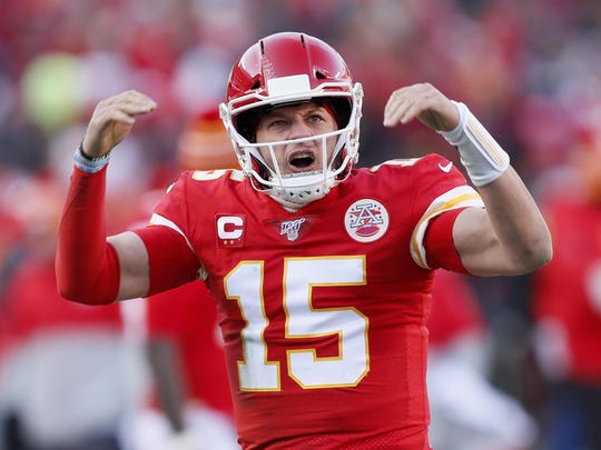 Chiefs' quarterback Patrick Mahomes reacts after throwing a touchdown pass to Tyreek Hill during the first half of the NFL AFC Championship football game.