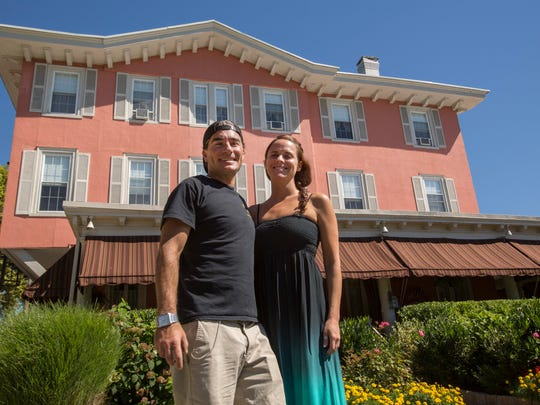 Jared Kaloostian and his fiancée Colleen Morris stand outside their Spring Lake bed and breakfast, The Ocean House.