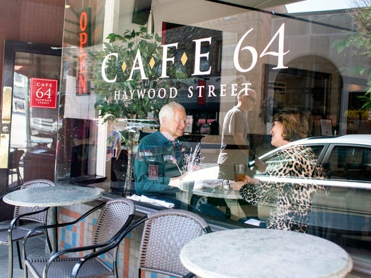 Dan and Deb Allen sit in the window at Cafe 64 in downtown Asheville enjoying breakfast Monday morning, March 23, 2015. The regulars said they eat at the small cafe about three times a week, stating they think the grits are the best around. The cafe offers breakfast and lunch every day at its Haywood Street location.