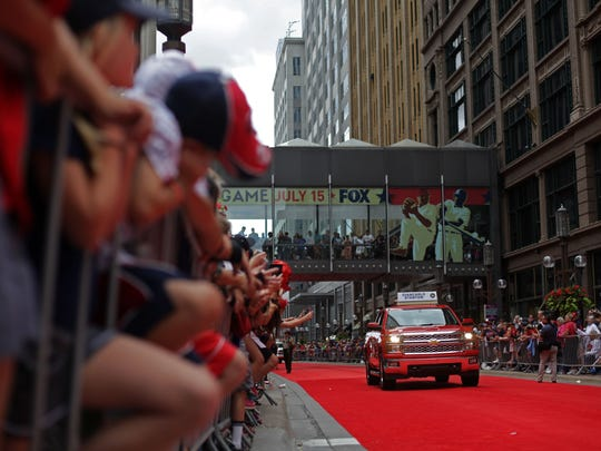 The All-Star Red Carpet Parade. Reds' officials are in town reviewing events outside the stadium.