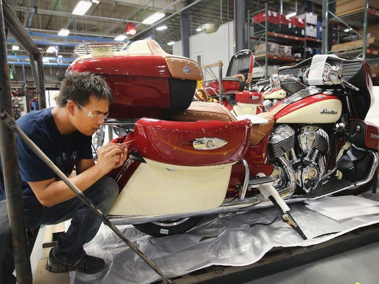 Jackie Donkhong puts the finishing touches on an Indian Roadmaster motorcycle at the end of the assembly line at the Polaris Industries factory Aug. 8 in Spirit Lake. Polaris is reintroducing the Indian Scout this year, a model used by U.S. troops in World War II.