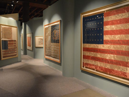 More than a dozen battle flags dating back to the Civil War are on display in a new State Historical Museum exhibit that opened Friday and remains through this summer.
