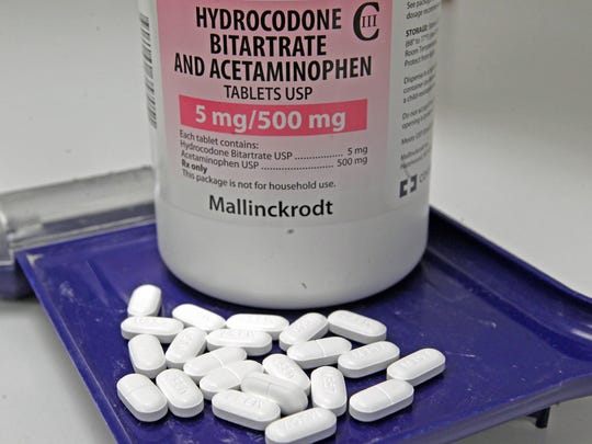 Hydrocodone bitartrate and acetaminophen pills, also known as Vicodin, are arranged for a photo.
