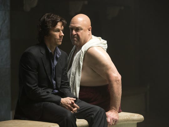 """In this image released by Paramount Pictures, Mark Wahlberg, left, and John Goodman appear in a scene from """"The Gambler."""""""