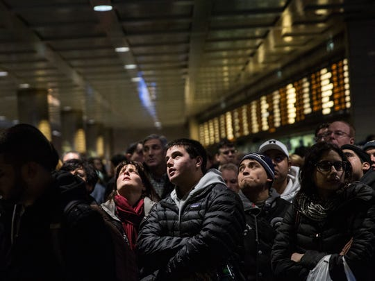 462295726.jpg NEW YORK, NY - JANUARY 26: People wait for their train platform to be announced at Penn Station while a major snowstorm begins on January 26, 2015 in New York City. The storm is expected to bring 1-3 feet of snow to the New York City region over the next 36 hours. (Photo by Andrew Burton/Getty Images) *** BESTPIX ***