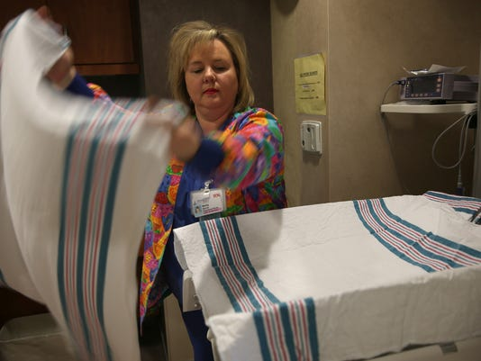 Chicago-area company to sell iconic hospital blankets to the public