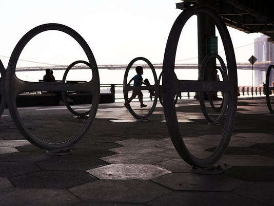 New Yorkers Cool Off Along Waterfront Park As Temperature Hit 90 Degrees