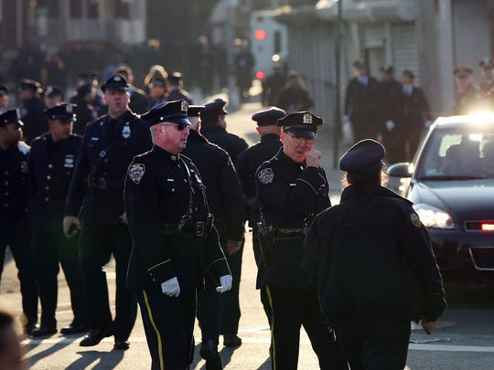 Police officers gather outside of Christ Tabernacle Church for the funeral of slain New York City Police Officer Rafael Ramos, one of two officers murdered while sitting in their patrol car in an ambush in Brooklyn last Saturday.