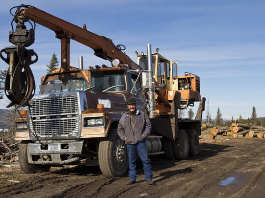 Standing next to his log loader, Bill Fenner prepares to continue harvesting timber on the Blackfeet Indian Reservation. As a Blackfeet tribal member, Fenner's family run business has been aided by additional access to native owned timberland.