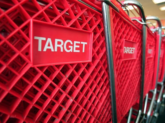 FILE - MAY 5, 2014: It was reported that Target replaced Chief Executive Officer Gregg Steinhafel in the wake of a massive data breach May 5, 2014. CHICAGO - MAY 23:  Shopping carts sit inside a Target store on May 23, 2007 in Chicago, Illinois. Today, Target Corp. reported an 18 per cent increase in their first-quarter profit, beating analysts' expectations.  (Photo by Scott Olson/Getty Images) ORG XMIT: 74220852 ORIG FILE ID: 74250546