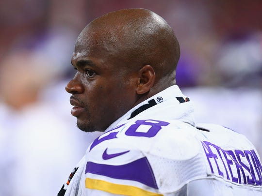 FILE - The NFL has suspended running back Adrian Peterson of the Minnesota Vikings without pay for at least the remainder of the 2014 season.