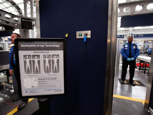 A sign at a Transportation Security Administration (TSA) checkpoint instructs passengers about the use of the full-body scanner at O'Hare International Airport on March 15, 2010 in Chicago, Illinois.