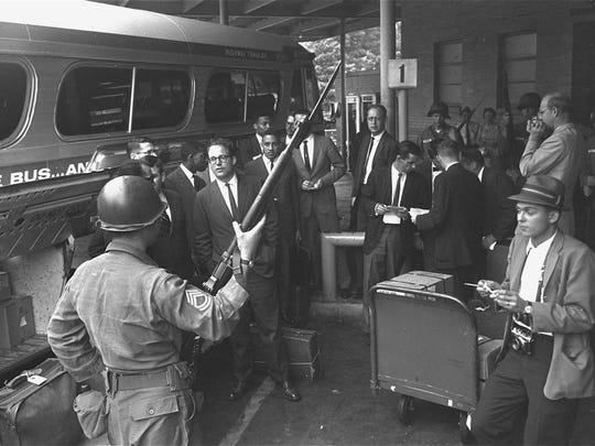 A group of Freedom Riders arrives in Montgomery on May 24, 1961, under guard of police and National Guard.