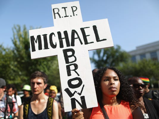 Rally At US Justice Department Calls For Justice In Ferguson Shooting Case