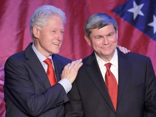 In this May 3 photo, former President Bill Clinton (left) talks with former Democratic Congressman Mike Ross at a fundraiser for Ross' campaign for governor in Little Rock. The state Democratic party announced Monday that Clinton is scheduled to headline rallies for Arkansas Democrats.
