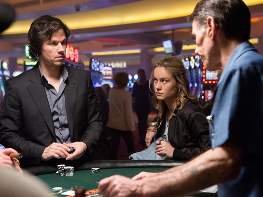 Mark Wahlberg and Brie Larson appear in a scene from The Gambler.