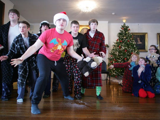 "Kalyb Chism, a senior, center, and his fellow Newark High School Swing Choir members, perform "" 'Twas the Night Before Christmas"" during Monday afternoon's Newark Kiwanis meeting at Buckingham House. The choir is directed by Kim Wigglesworth."