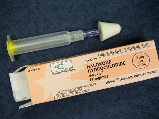 A kit of Naloxone, a heroin antidote that can reverse the effects of an opioid overdose, is displayed at a press conference about a new community prevention program for heroin overdoses in which New York police officers will carry kits of Naloxone.