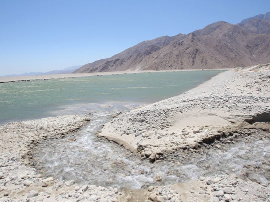 Water flows into a percolation pond at the Whitewater River groundwater replenishment facility on the outskirts of Palm Springs.