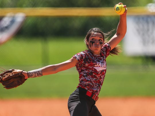 West Florida Jaguars pitcher Korina Rosario winds up her pitch against P.K. Yonge Development Research School in the 4A State Championship game at Historic Dodgertown in Vero Beach on Thursday. West Florida High won the state title, 6-5.