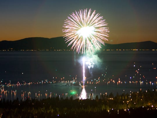 In this July 2007 photo, fireworks exploding over Lake Tahoe are seen from Heavenly Mountain Resort.