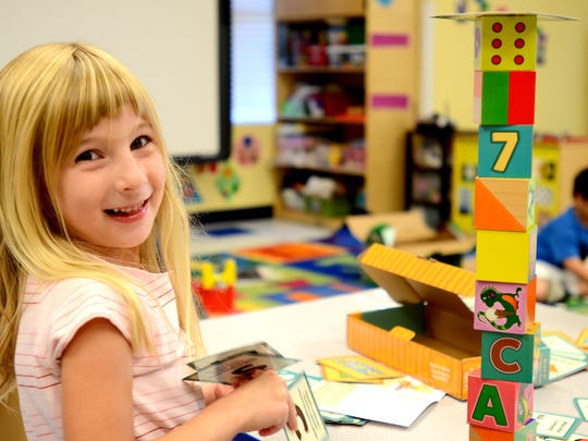 Ava Wozniak, 5, plays with the Smarty Blocks during class at The Goddard School in Sparks on Monday, Oct. 6, 2014.