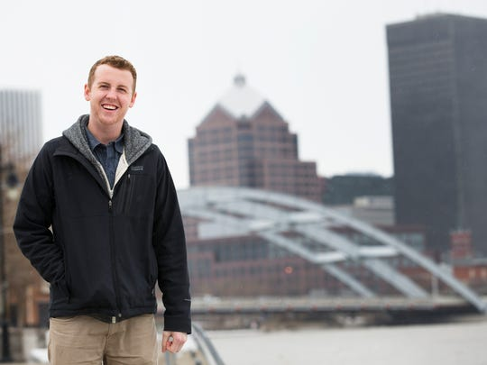 Steve Carter, founder of Explore Rochester, stands along the Genesee River on Friday.