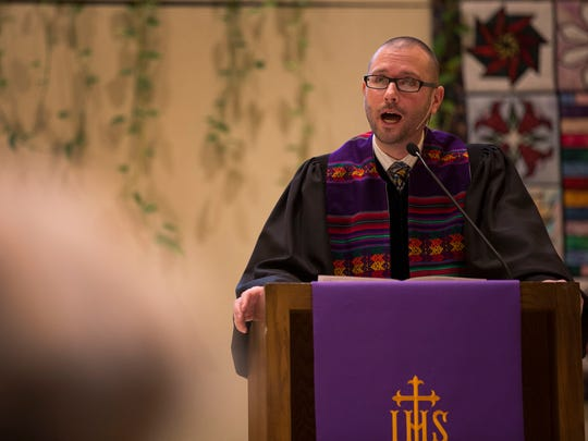 Reverend Michael Ford speaks to his congregation during a service on March 15.