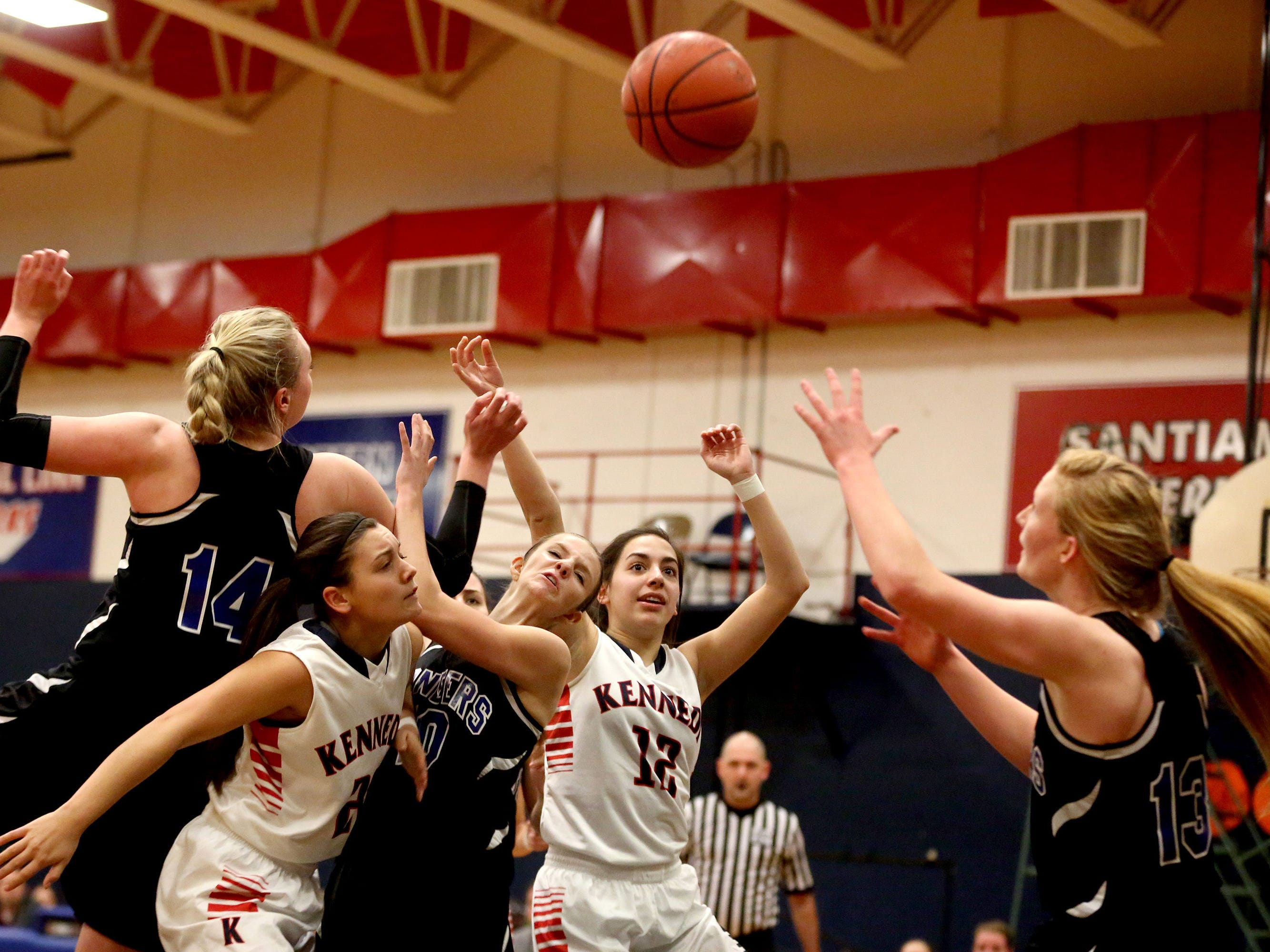 From left, Western Mennonite's Emma Gibb (14), Kennedy's Rebecca Pranger (20), Western Mennonite's Amy Rausch (10), Kennedy's Lakin Susee (12), and Western Mennnonite's Madison Hull (13) fight for a loose ball in the first half of the Western Mennonite vs. Kennedy girl's basketball game at Kennedy High School in Mt. Angel, Ore., on Tuesday, Jan. 6, 2015. Western Mennonite won the game 57-41.