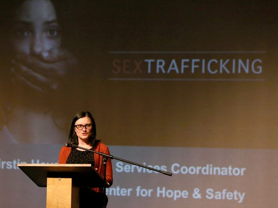 Kirstin Heydel, with the Center for Hope and Safety, speaks during an event called In Plain Sight, at McNary High School.