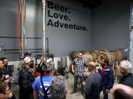 Vagabond Brewing co-owner Dean Howes talks with a group from the Craft Brewers Conference that stopped by the brewery for a tour on Tuesday.