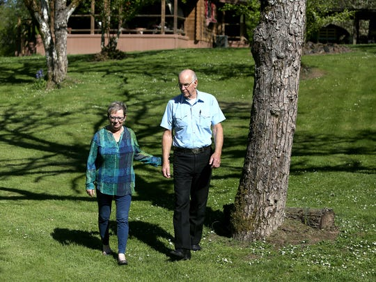 Freddi Wacken walks with her husband, Larry, at their West Salem home Friday, April 17.