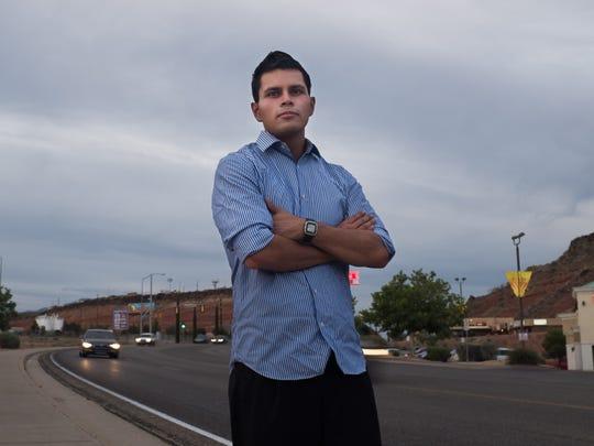 Roberto Jardon poses for a portrait near a restaurant