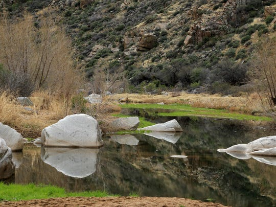 Rocks reflect in the pooled waters of the Agua Fria River in Arizona's Agua Fria National Monument north of Phoenix.
