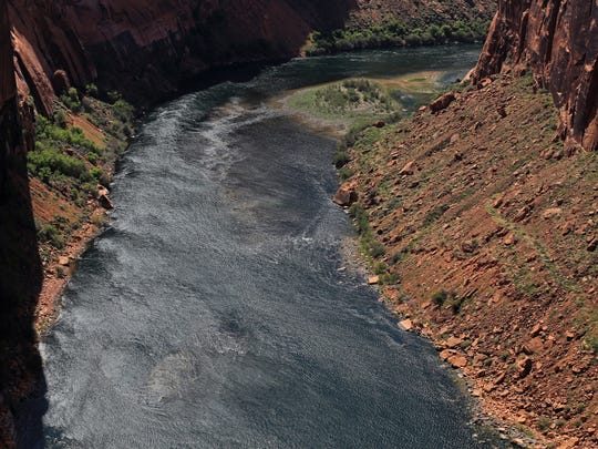 The Colorado River flows through Glen Canyon just downstream from Lake Powell.