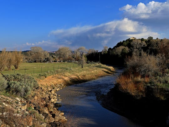 The Sevier River flows through farmland between Panguitch and Red Canyon.
