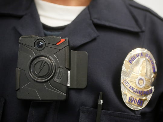 A Los Angeles Police officer wears a body camera during