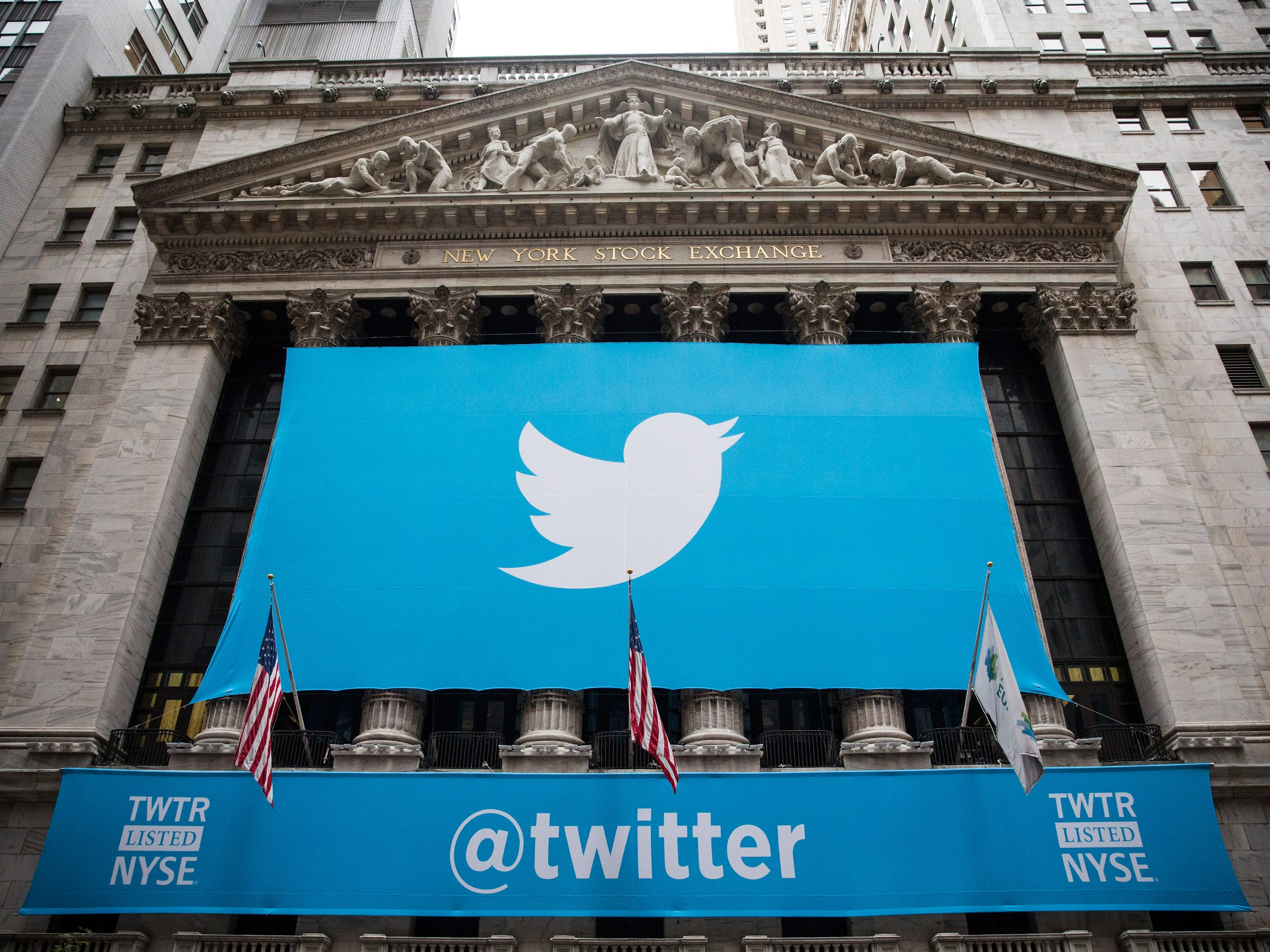 The Twitter logo is displayed on a banner outside the New York Stock Exchange on Nov. 7, 2013.